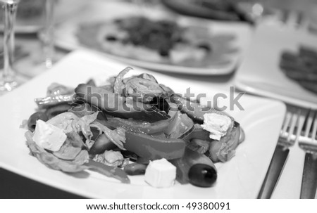 Fresh salad with oil and olives in bowl