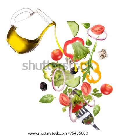 Fresh salad with poured olive oil - stock photo