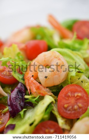 Fresh salad with prawns.