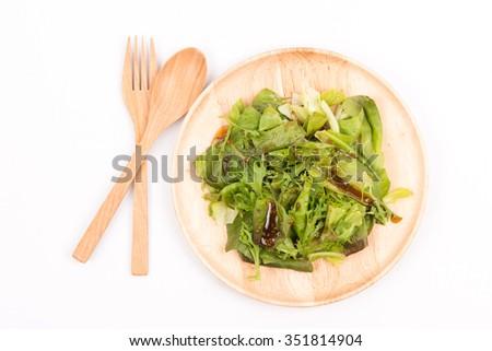 Fresh salad with salad oil and sesame - stock photo