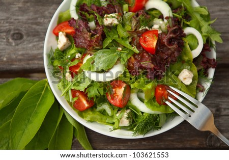 fresh salad with tomato and cucumber.green salad