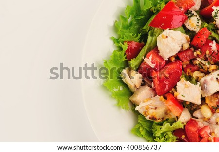 fresh salad with tomato and meat