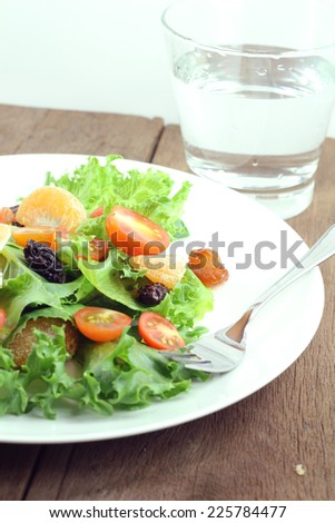 Fresh salad with tomatoes and green.
