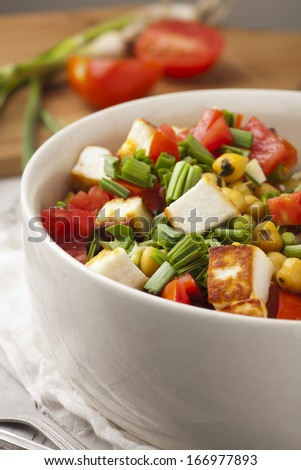 fresh salad with tomatoes garlic and chickpea
