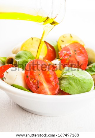 Fresh salad with tomatoes, mozzarella and olive oil