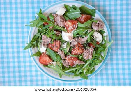 fresh salad with tomatoes, ruccola and tuna - stock photo