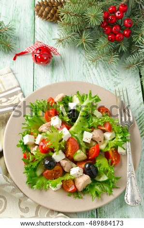 Fresh salad with tuna, tomatoes and cucumbers on lettuce leaves