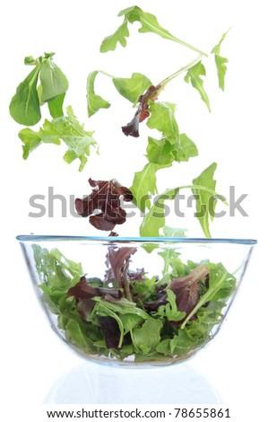 Fresh salad with vegetable in motion. - stock photo