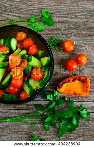 Fresh salad with vegetables and tomatoes. Top view - stock photo