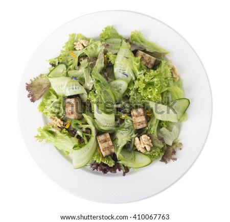 Fresh salad with walnuts and grilled tofu cheese. Isolated on a white background.