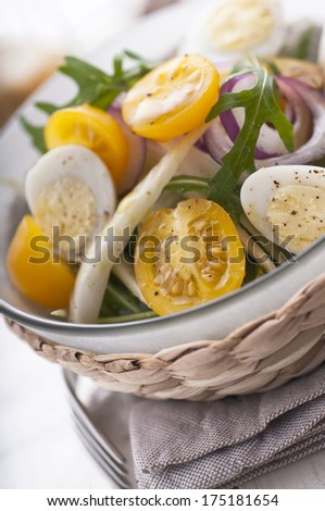Fresh salad with yellow cherry tomatoes, fennel and quail eggs - stock photo