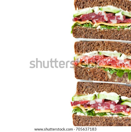 Fresh salami sandwiches with vegetables wrapped in paper on white background with place for text.
