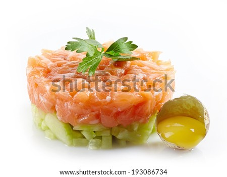 fresh salmon and cucumber tartare and raw egg