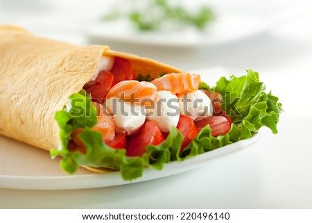 Fresh Salmon Burrito with Cream Cheese and Vegetables - stock photo