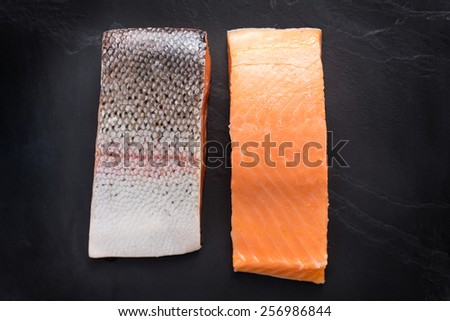 Fresh salmon  fillet on black background - stock photo