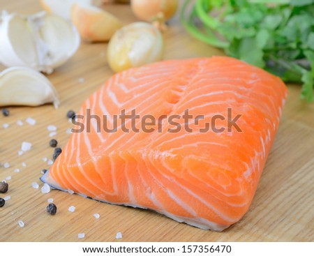 Fresh salmon fillet on the wooden background - stock photo