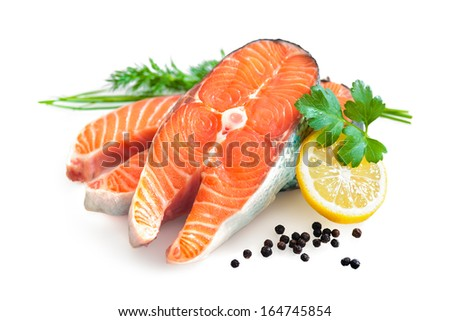 fresh salmon fillet with parsley and lemon slices isolated on white - stock photo