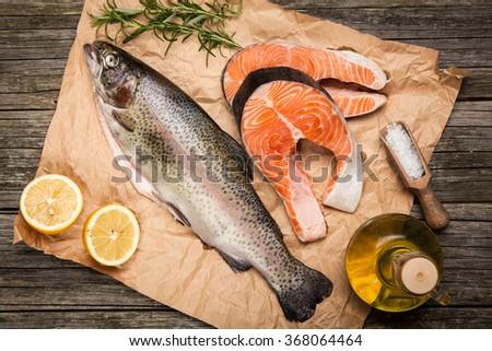 Fresh salmon on old wood - stock photo