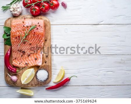 Fresh salmon on the cutting board. Cooking process. - stock photo