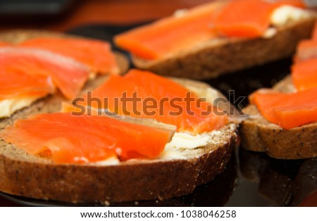 Fresh salmon sandwich with salted salmon and butter and dark bread