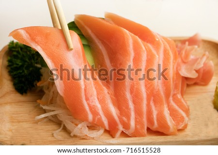 Fresh Salmon slice in the wooden plate