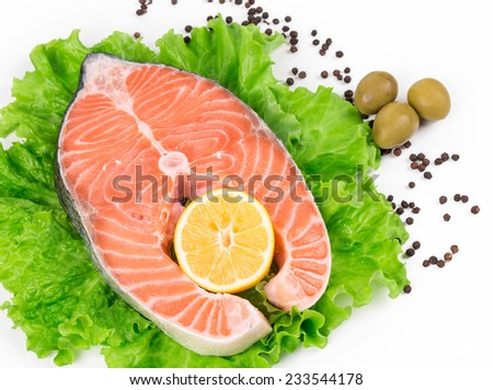 Fresh salmon steak on lettuce. Isolated on a white background.