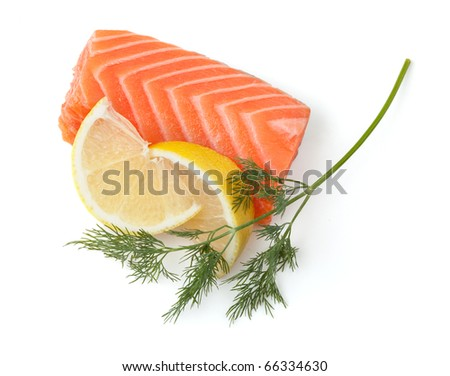 Fresh salmon steak with lemon slices and dill. Isolated on white background - stock photo