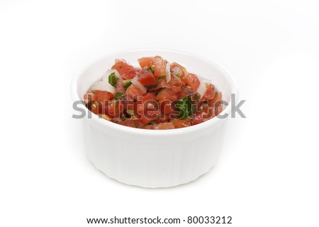 Fresh salsa in a bowl against a white background - stock photo