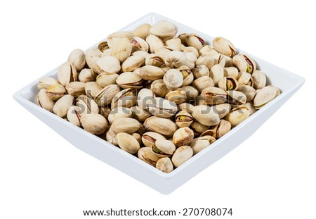 Fresh Salt Pistachios in a white bowl  isolated on white background - stock photo