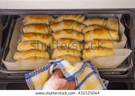 Fresh salty butter roll bread in the oven - stock photo