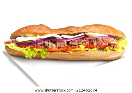 fresh sandwich close up with vegetables and meat fish isolated on white background
