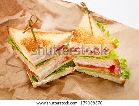 Fresh Sandwiches on kraft paper  - stock photo