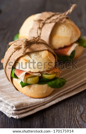 Fresh sandwiches with ham and vegetables. Rustic style. - stock photo