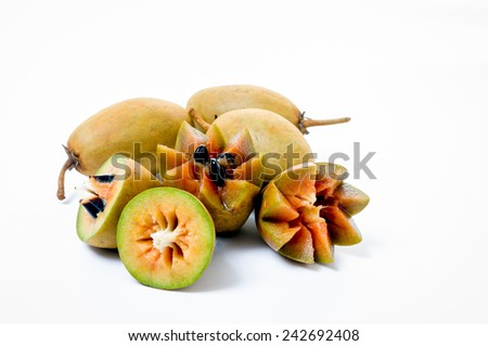 Fresh sapodillas isolated on white background - stock photo