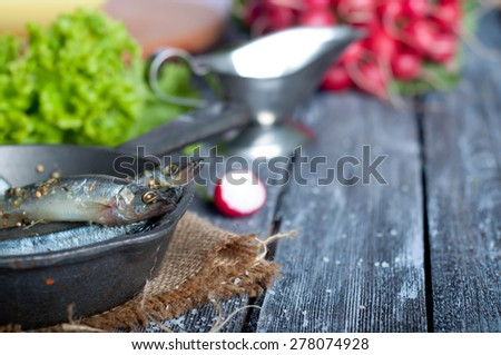 Fresh sardines. Fish with vegetables. Mediterranean fish on plate
