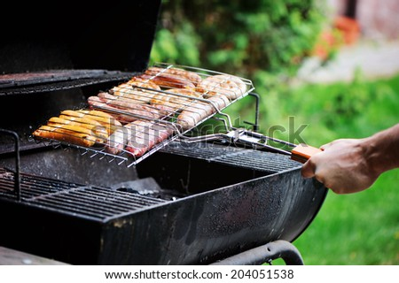 Fresh sausages on grill  - stock photo