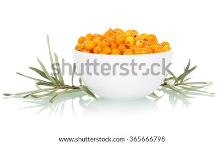 Fresh sea buckthorn berries in white bowl closeup isolated on white background - stock photo