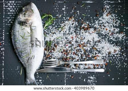 Fresh sea fish against a dark background. - stock photo