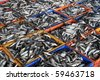 Fresh sea fishes in crates. An Indian market scene - stock photo