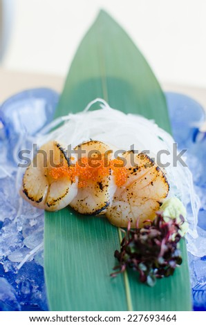Fresh sea scallops sashimi with fish roe , Japanese style food - stock photo