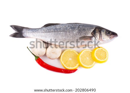 Fresh seabass with lemon. Isolated on a white background.