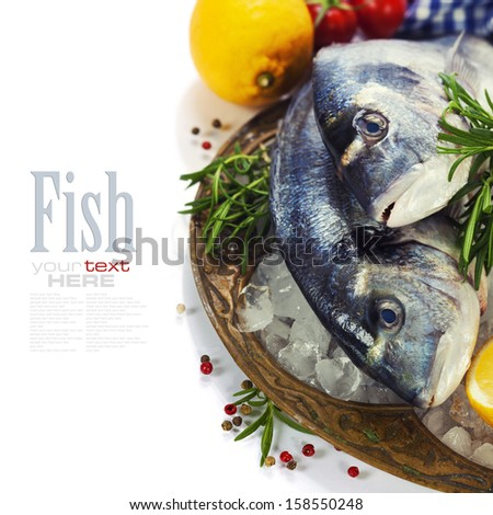 fresh seafood and vegetables on ice - food and drink (with easy removable sample text) - stock photo