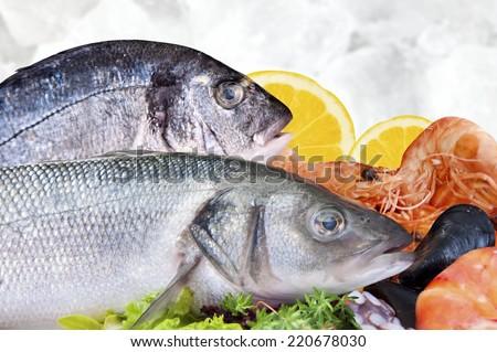 Fresh seafood arrangement displayed in market - stock photo