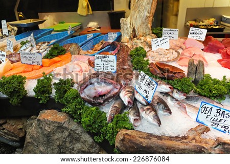 Fresh seafood at fish market stall - stock photo