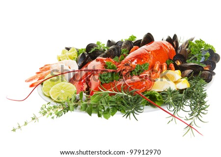 Fresh seafood dish with lobster on a white background - stock photo