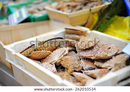 Fresh seafood in white box for sale on fish market of Paris, France - stock photo