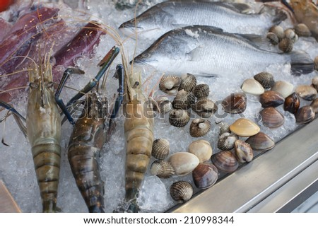 Fresh seafood photographed in fish market - stock photo