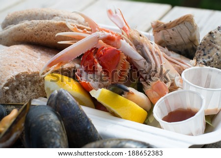 Fresh seafood platter served with lemon and bread