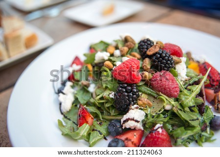 Fresh Seasonal Berries and Arugula Salad Served with Fresh Goat Cheese