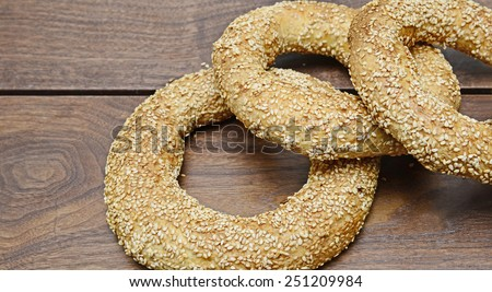 Fresh sesame breads on a rustic wooden background